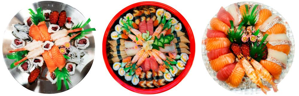 Metos sushivalikoima, kolme pyöreää tarjotinta